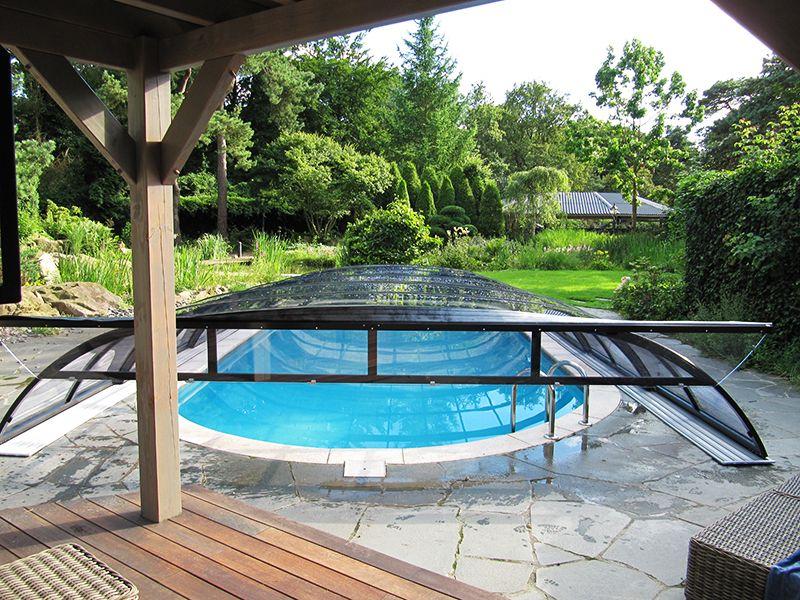 Een zwembadoverkapping een luxe of een noodzaak tuin for Tuin uittekenen